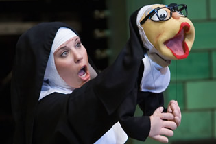Sister Amnesia shocks the crowd with her puppet, Sister Mary Annette.